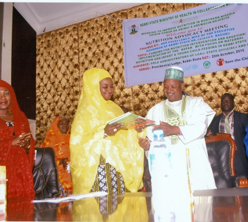 HE, Governor Bagudu handling copies of the National Strategic Plan of Action for Nutrition (NSPAN) to his wife